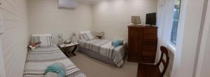 A bed or beds in a room at Curlew Cottage