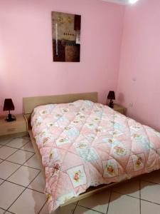 A bed or beds in a room at Martil Mixta Safia