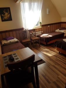 Łóżko lub łóżka w pokoju w obiekcie Pensjonat Li-Mar