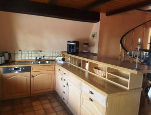 A kitchen or kitchenette at Ihr Urlaub ist unsere Herzenssache