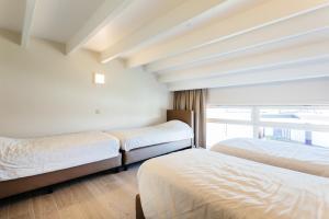 Een bed of bedden in een kamer bij Holiday Home Jonckershof