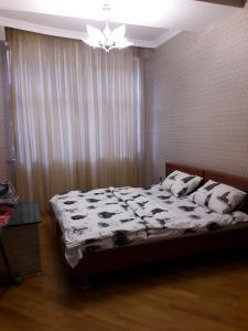 Cama ou camas em um quarto em SAHIL 2 ZARIFA ALIEVA 27 Street