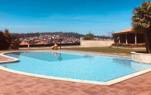 The swimming pool at or near Palácio das Camélias