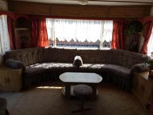 A seating area at Гостевой Домик У Томы как Дома