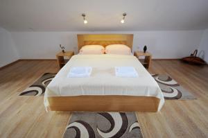 Postel nebo postele na pokoji v ubytování Guest House Korita