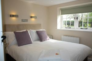 A bed or beds in a room at The Rectory Lacock