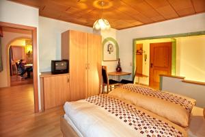 A bed or beds in a room at Haus Brugger