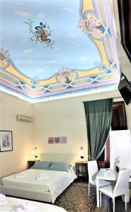 A bed or beds in a room at Art Déco B&B