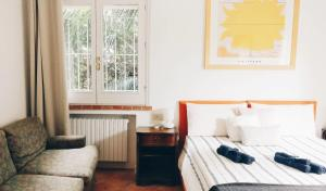 A bed or beds in a room at B&B Casa Chinaski