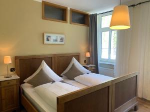 Ein Bett oder Betten in einem Zimmer der Unterkunft Moselland Hotel im Enderttal Zum Onkel Willi