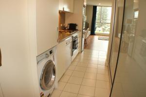A kitchen or kitchenette at Beachside Luxury 2 Bedroom Getaway