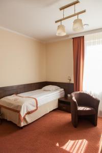 Łóżko lub łóżka w pokoju w obiekcie Hotel Ostrawa