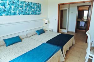 Een bed of bedden in een kamer bij Ohtels Cabogata