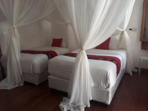 A bed or beds in a room at Rua Beach Resort Sumba