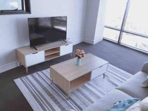 A television and/or entertainment center at Perfect location for events@Sydney Olympic Park