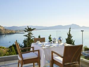 A restaurant or other place to eat at Lindos Mare, Seaside Hotel