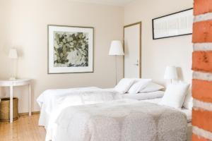 Säng eller sängar i ett rum på Lossiranta Lodge