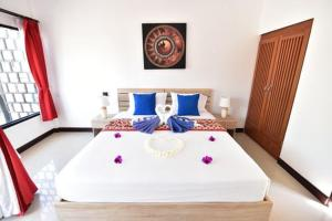 A bed or beds in a room at The Reef Resort