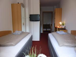 A bed or beds in a room at Hotel/Restaurant Balkan
