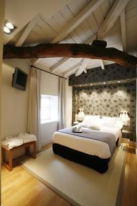 Ein Bett oder Betten in einem Zimmer der Unterkunft Hotel Palacio Muñatones