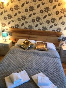 A bed or beds in a room at Kilcloon Self Catering Cottages & Studios