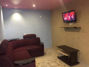 A television and/or entertainment center at Astoria Hotel Kyrylivka