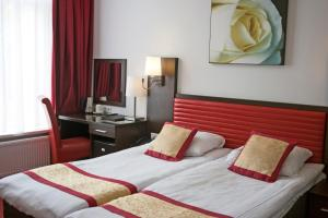 A bed or beds in a room at Hotel Allure