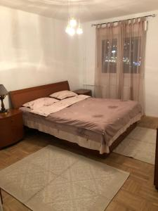 A bed or beds in a room at Enver Maloku