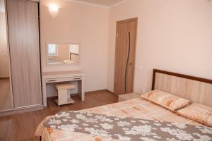 A bed or beds in a room at Guest House Family Comfort