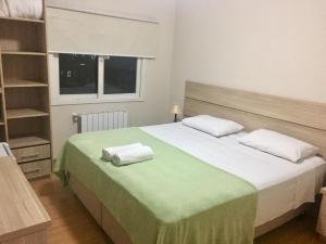 A bed or beds in a room at Hotel Carpevita