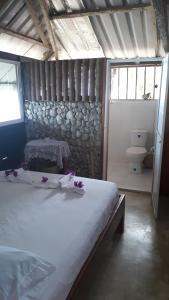 Una cama o camas en una habitación de Cabañas Refugio Salomon