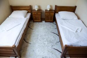 Posteľ alebo postele v izbe v ubytovaní Hotel Rubín