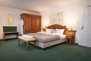 Ein Bett oder Betten in einem Zimmer der Unterkunft Landhaus Lellichow