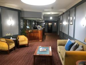The lobby or reception area at Highfield House Hotel