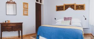 A bed or beds in a room at Yasemi of Chios