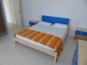 Postel nebo postele na pokoji v ubytování Condominio Nautilus