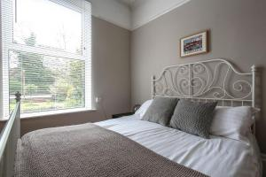 A bed or beds in a room at Baytree Lodge Chester