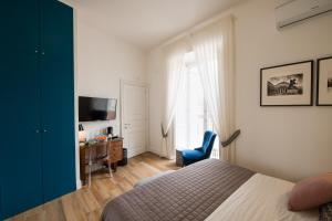 A bed or beds in a room at Santa Chiara Boutique Hotel