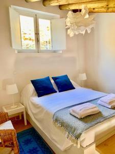 Uma cama ou camas num quarto em Casas de Mértola