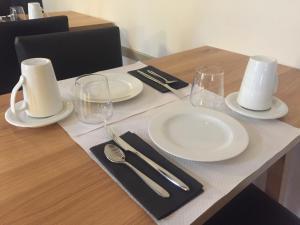 A restaurant or other place to eat at Le Relais de la Calèche