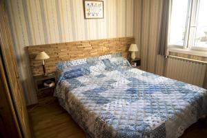 Un ou plusieurs lits dans un hébergement de l'établissement Chambres d'hôtes proche d'Annecy
