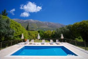 The swimming pool at or near Forest Villas Kefalonia