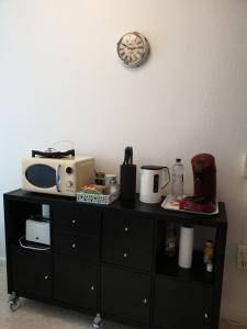 Coffee and tea making facilities at Apartment-Leopoldstreet