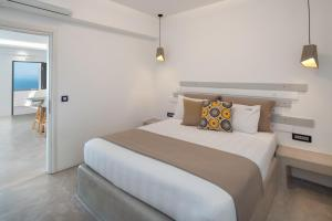 A bed or beds in a room at Belle Etoile Villas