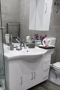 A bathroom at Apartmani Pleasure 1 i 2