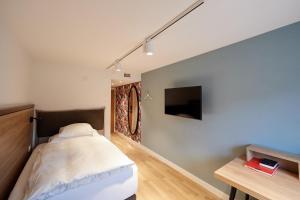 Ein Bett oder Betten in einem Zimmer der Unterkunft Hotel Restaurant zum goldenen Kopf