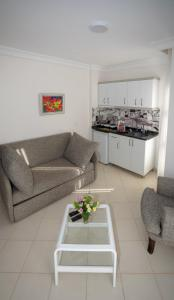 A kitchen or kitchenette at Mitos Apartments