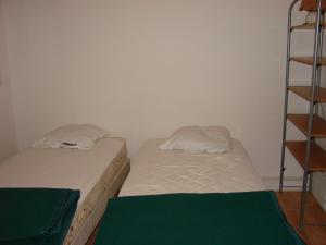 A bed or beds in a room at ACCI Cannes Bivouac