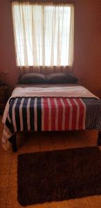 A bed or beds in a room at ELLIS HOME
