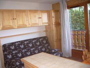 Un ou plusieurs lits dans un hébergement de l'établissement Studio Yeti Immobilier